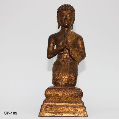 Thailändischer kniender Mönch